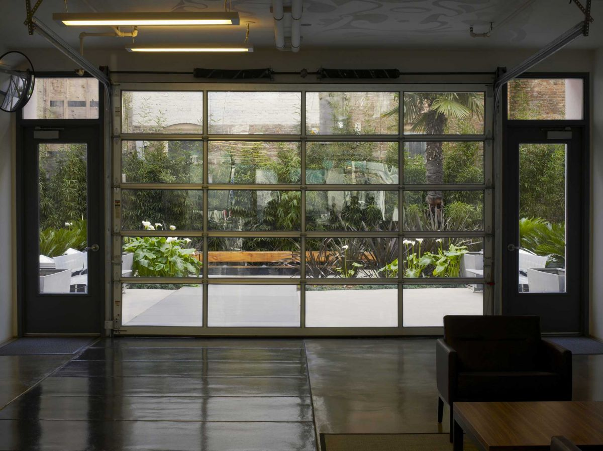 Glass garage door all garage and roll up doors garage amp roll up - The Glass Garage Style Door At The Back Of The Lobby Rolls Up To Create A Large Open Air Gathering Space Image Marion Brenner