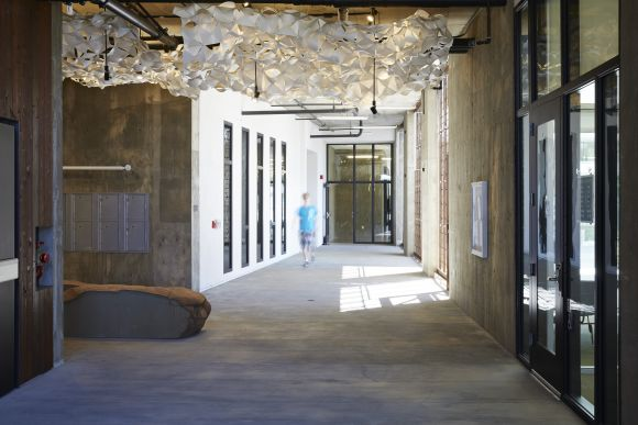 the lobby breezeway connects the entry offices mailroom garage entry activity room and community room image mariko reed breezeway garage office